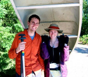 Linnea and Dave with a canoe before the Mississippi River trip
